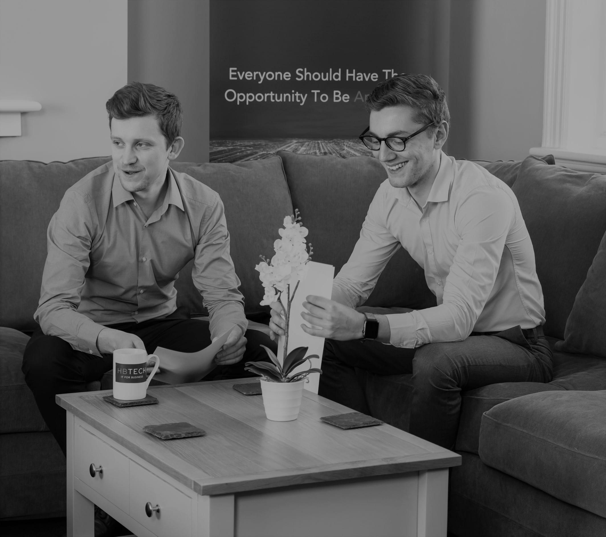 IT company Southampton providing IT services Southampton, 2 men laughing on couch.